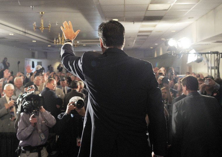 "U.S. Republican presidential candidate Mitt Romney waves after speaking at a ""Veterans for Romney"" campaign event in Springfield, Virginia, on September 27, 2012. (Jewel Samad/AFP/Getty Images)"