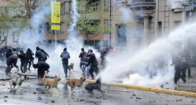 Students clash with riot police during a protest demanding that Chilean President Sebastian Pinera's government improve public education quality in Santiago, on September 27, 2012. (Martin Bernett/AFP/Getty Images)