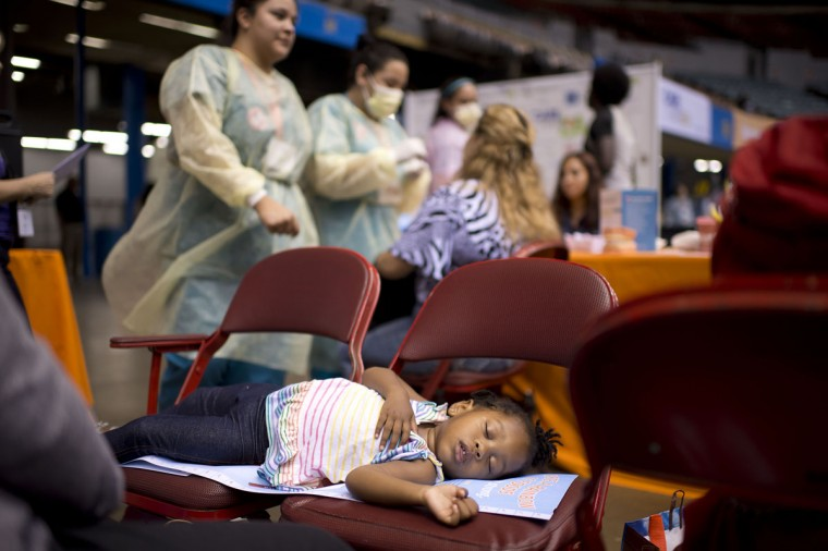Two-year-old Alana Marie sleeps as her mother waits for dental care, on the first day of the fourth annual free health clinic at the Los Angeles Sports Arena in downtown Los Angeles September 27, 2012. The free clinic, organized by nonprofit Care Harbor, aims to provide medical, vision and dental care at no charge for thousands of needy residents over a four day period. Health care is one of the top issues in the upcoming presidential election. Some 49.9 million Americans, or 16.3 percent of the total US population, are uninsured, according to CNN. (Robyn Beck/AFP/Getty Images)