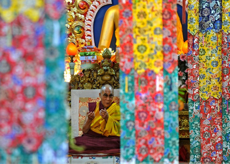 Tibetan Spiritual Leader The Dalai Lama gestures during a prayer meeting at The Namgyal Monastry in Dharamshala. The prayer meeting was held on the concluding day of the four-day second Special General meeting of Tibetans which was held in Dharamshala to discuss the critical issues of recent self immolations by Tibetans in Tibet, and about taking up the Tibet issue with new Chinese leadership. (Manjunath Kiran/AFP/Getty Images)