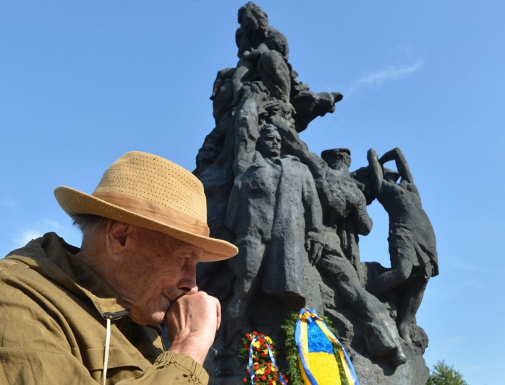 A man wipes his nose at the Babiy Yar monument in Kiev on September 29, 2012 during a remembrance ceremony marking the 71st anniversary of the beginning of mass execution of Jews by the Nazis in September 1941. Some 34,000 Jews were murdered over two days in September 1941 on Babiy Yar, a plazza in Kiev rendering it a symbol of the Holocaust where Nazis shot more than 100,000 people between 1941 and 1944. (Sergei Supinsky/AFP/Getty Images)