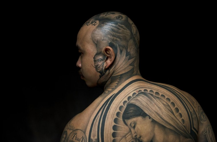 """Oldies"" poses for a photograph to display his tattoos by artist Josh Lin during the 8th International London Tattoo convention at Tobacco Dock east London. World famous tattoo artists gathered in London for the annual event. (Adrian Dennis/AFP/GettyI mages)"