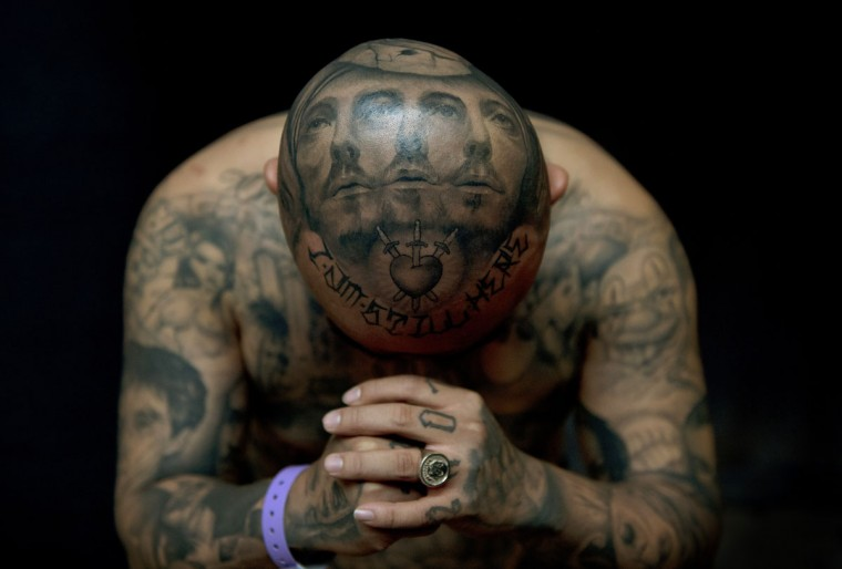 """Oldies"" poses for a photograph to display his tattoos by artist Josh Lin during the 8th International London Tattoo convention at Tobacco Dock east London. (Adrian Dennis/AFP/GettyI mages)"