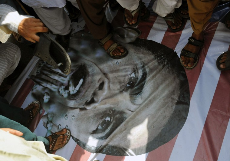 Pakistani protesters step on a portrait of U.S. President Barack Obama as they participate in a protest rally against an anti-Islam film in Karachi. Thousands of people thronged the streets of Pakistan's biggest city in the latest protest against the U.S.-made film, police and witnesses said. (Rizwan Tabassum/AFP/Getty Images)