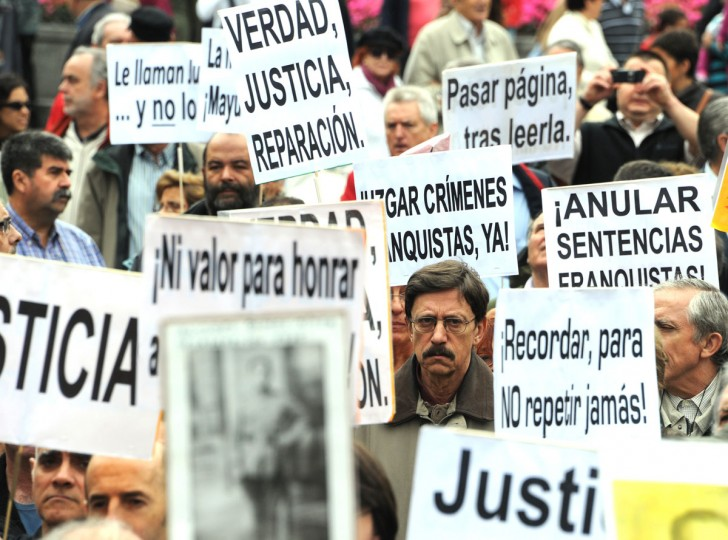 People attend a demonstration to demand justice for the victims of Franco's regime and to publicly recognize the labor of Spain's judge Baltasar Garzon in Madrid. Spain's top court acquitted renowned judge Baltasar Garzon on February 27, 2012 of abuse of power by trying to investigate Franco-era atrocities, in a case that exposed deep wounds dating back to the civil war. (Dominique Faget/AFP/Getty Images)
