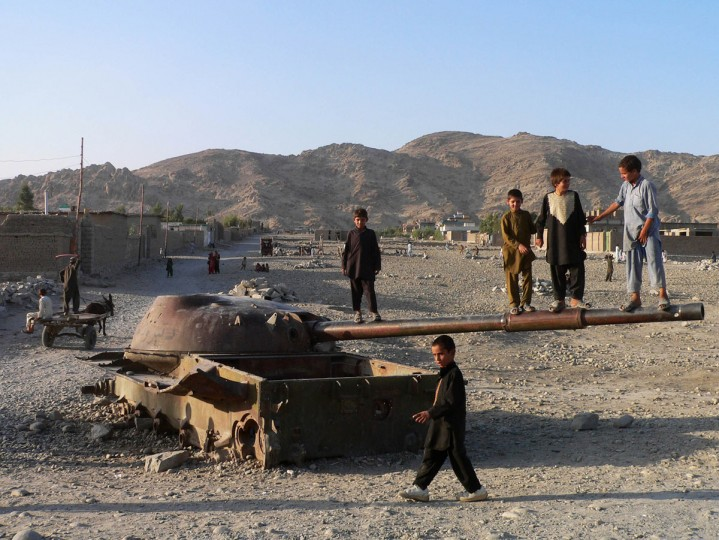 Afghan children play on the remains of an old destroyed Soviet tank in the eastern Afghan city of Jalalabad. Former Soviet Union troops occupied Afghanistan in December of 1979 and after a decade of conflict in Afghanistan, they pulled out leaving in its wake a civil war that gripped the country for years. (Noorullah Shirzada/AFP Getty Images)