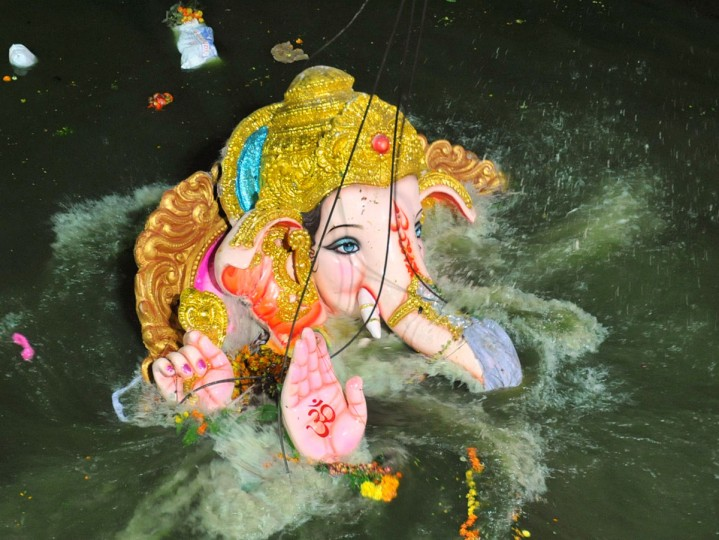An idol of the elephant-headed Hindu god Ganesh is immersed into the Hussain Sagar Lake in Hyderabad, India. Hindu devotees bring home and offer prayers in temporary temples built for idols of Lord Ganesha in order to invoke his blessings for wisdom and prosperity during the ten-day Ganesha Festival, culminating with the immersion of the idols in bodies of water, including the ocean. (Noah Seelam/AFP/Getty Images)