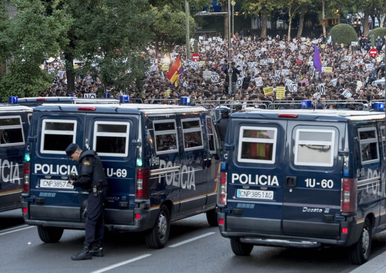 "Police vans block a street leading to the parliament building in Madrid during a demonstration organized by Spain's ""indignant"" protesters, a popular movement against a political system that they say deprives ordinary Spaniards of a voice in the financial crisis. (Dani Pozo/AFP Getty Images)"