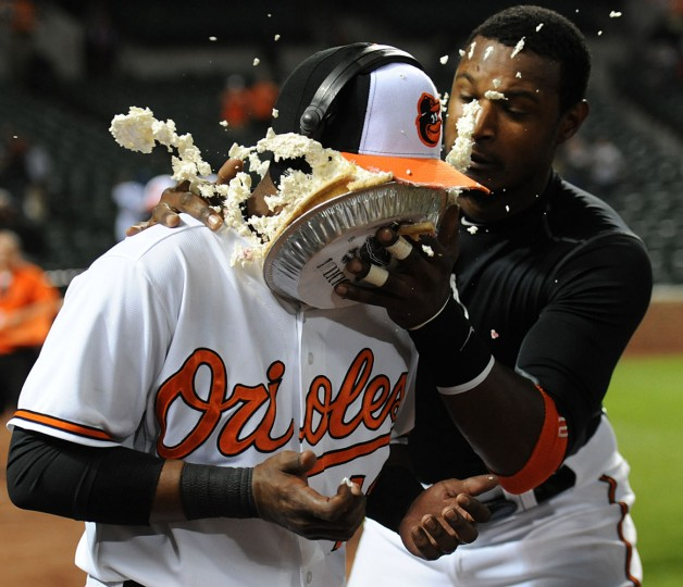 May 2015: Baltimore Orioles' Rey Navarro gets a pie in the face from Adam Jones, right, after hitting his first major league home run against the Toronto Blue Jays in the eighth inning of a baseball game Wednesday, May 13, 2015, in Baltimore. The Orioles won 6-1. (AP Photo/Gail Burton)