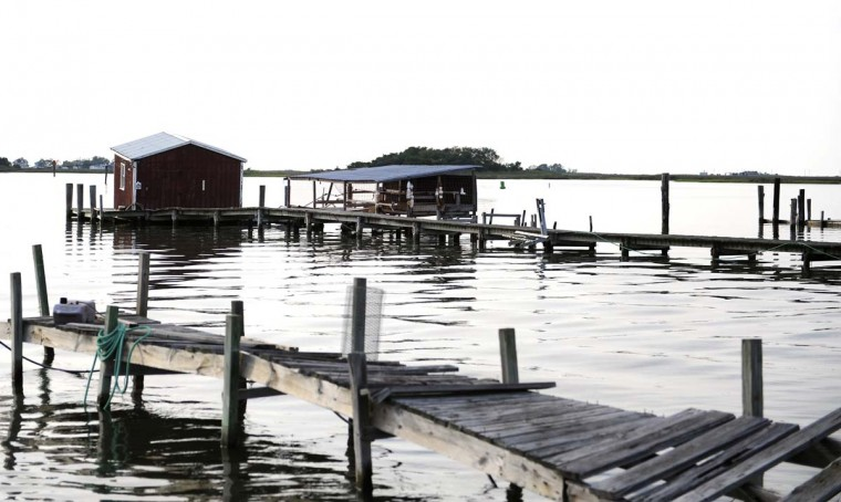 This is a view of sun down docks and crab shacks in the town of Tylerton on Smith Island. There are only a few crabbers left, and only 55 full time residents of the once-thriving town. (Barbara Haddock Taylor/Baltimore Sun)