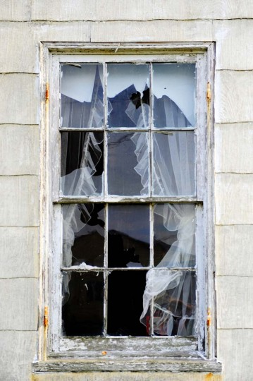 This is a broken window with curtains in an abandoned house on Smith Island. There are many empty houses now, as there are only 55 full time residents still living in the once-thriving town. (Barbara Haddock Taylor/Baltimore Sun)