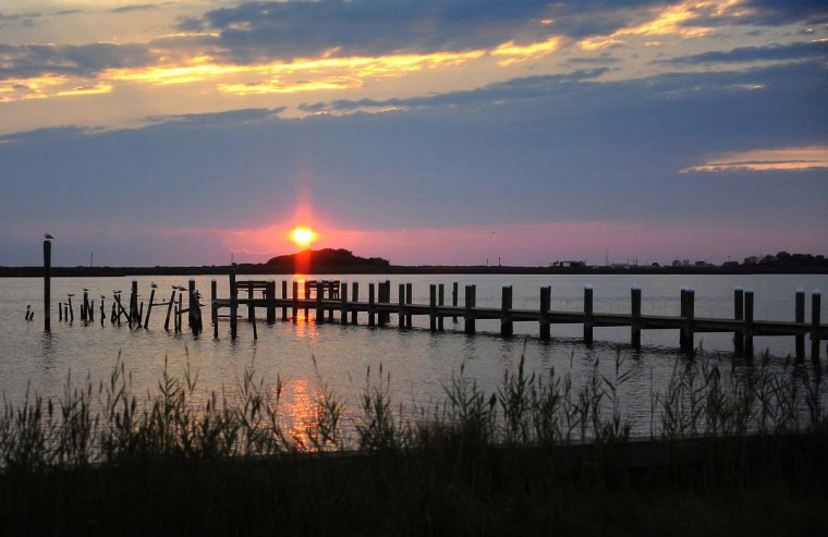 """A sunset as seen from the """"Inn of Silent Music"""" bed and breakfast porch, which is located on Tylerton road on Smith Island. (Barbara Haddock Taylor/Baltimore Sun)"""