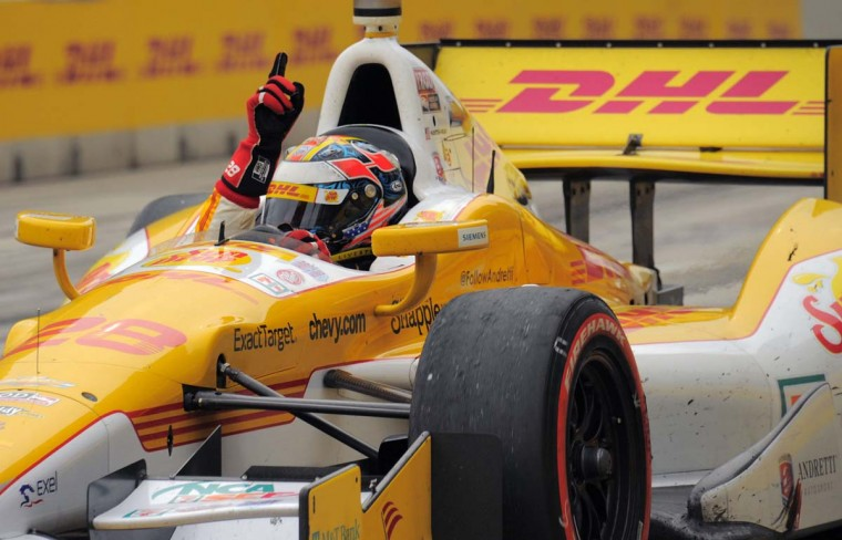 Race car driver Ryan Hunter-Reay gestures to the crowd after winning the Grand Prix of Baltimore. (Karl Merton Ferron/Baltimore Sun)