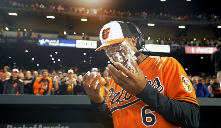 April 2015: Baltimore Orioles' Jonathan Schoop (6) smiles after getting hit with two pies while talking about his grand slam home run against the Toronto Blue Jays at Oriole Park at Camden Yards. Baltimore beat Toronto, 7-1, with a stellar outing by starting pitcher Ubaldo Jimenez. (Karl Merton Ferron/Baltimore Sun)
