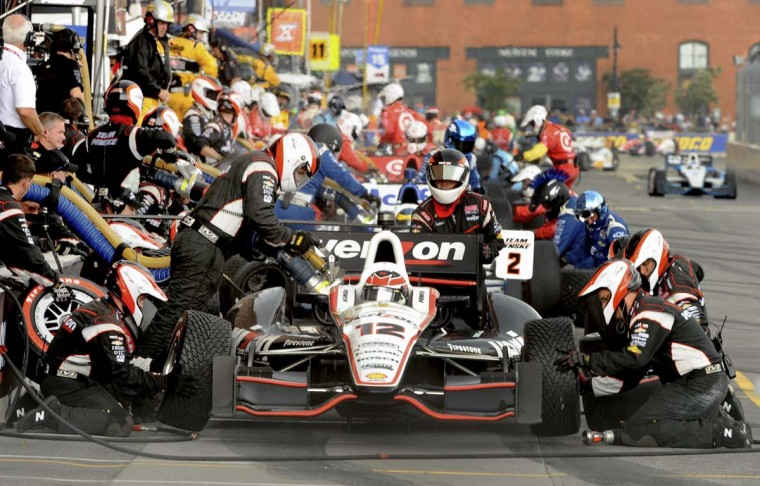 Shown is the pit stop that may have cost Will Power the race, when he pitted for intermediate rain tires, then very little rain came. (Gene Sweeney Jr./Baltimore Sun)