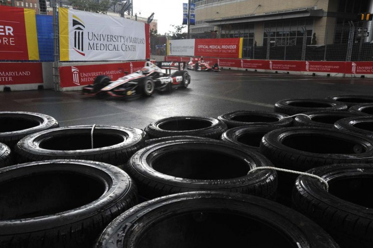 Driver Will Power maneavers around turn 12 onto Pratt Street as rain started to come down during the first part of the Grand Prix of Baltimore. (Robert K. Hamilton/Baltimore Sun)