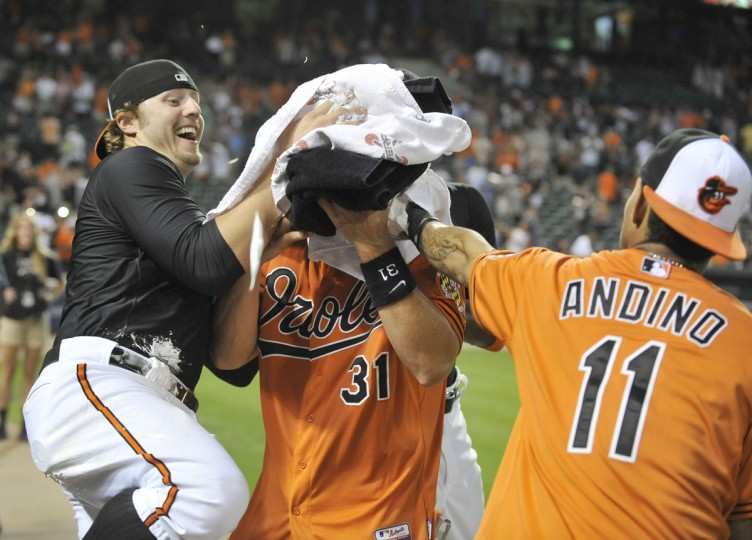 July 14, 2012: Catcher Taylor Teagarden has shaving cream shoved in his face by teammates Mark Reynolds and Robert Andino after Teagarden hit a game-winning, two-run homer in the 13th inning of a game against the Detroit Tigers. (Lloyd Fox/Baltimore Sun Photo)