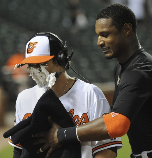 June 12, 2012: Second baseman Brian Roberts gets a shaving cream pie in the face, softly, from teammate Adam Jones. In his first major league game since May 2011, Roberts had a three-hit game and added a sacrifice fly. (Gene Sweeney Jr./Baltimore Sun Photo)