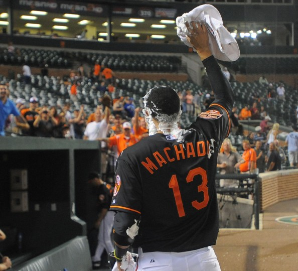 Aug. 10, 2012: Manny Machado waves to the crowd as he walks off the field with shaving cream covering his head. Machado took a shaving cream pie to the face after hitting two home runs against the Kansas City Royals. (Gene Sweeney Jr./Baltimore Sun Photo)