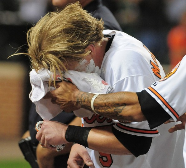 Sept. 12, 2012: Orioles left fielder Nate McLouth gets a shaving cream pie to the face following his walk-off single in a 3-2 win over the Rays. (Gene Sweeney Jr./Baltimore Sun Photo)
