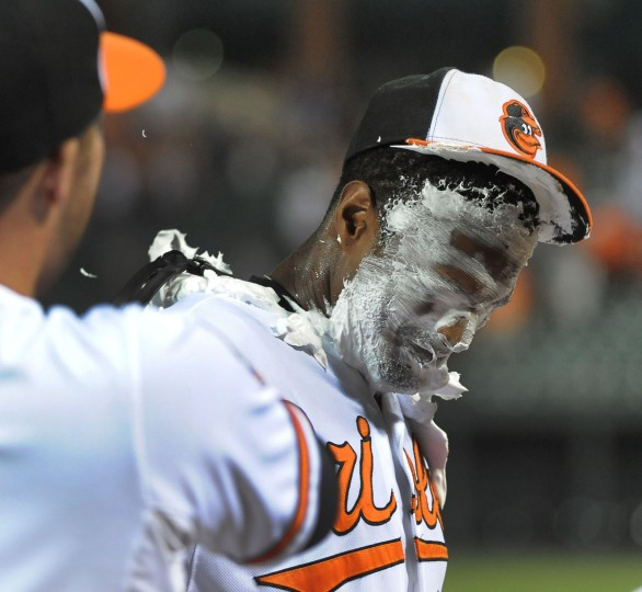 Sept. 6, 2012: Adam Jones got a taste of his own medicine after teammate Tommy Hunter threw a shaving cream pie at Jones' face. Jones hit the game-winning home run in the 8th inning of a game against the Yankees. (Gene Sweeney Jr./Baltimore Sun Photo)