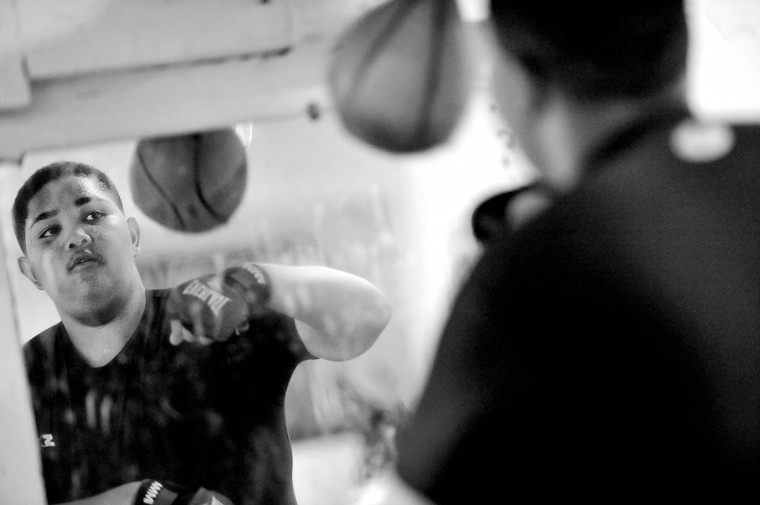 Begus Gee, 16, hits the speed bag in the UMAR Boxing Program, Inc. gym. (Kim Hairston/Baltimore Sun)