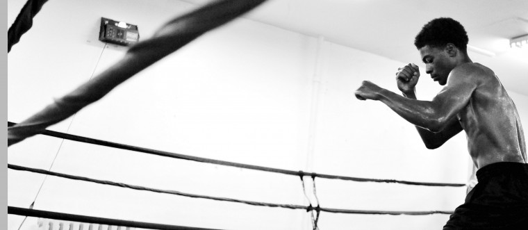 """Charles Johnson, 17, welter weight, shadowboxes in the UMAR Boxing Program, Inc. ring. While doing this exercise he thinks about his next opponent and says """"I'm looking into the future."""" Johnson, who has been in the sport for six years, says """"It's in my blood."""" (Kim Hairston/Baltimore Sun)"""