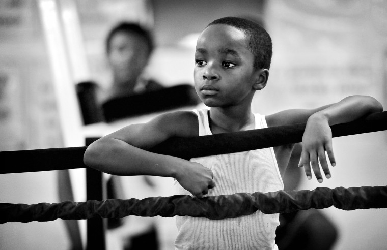 Muhammad Robinson, 9, watches the action inside the boxing ring at the UMAR Boxing Program, Inc. on North Avenue.