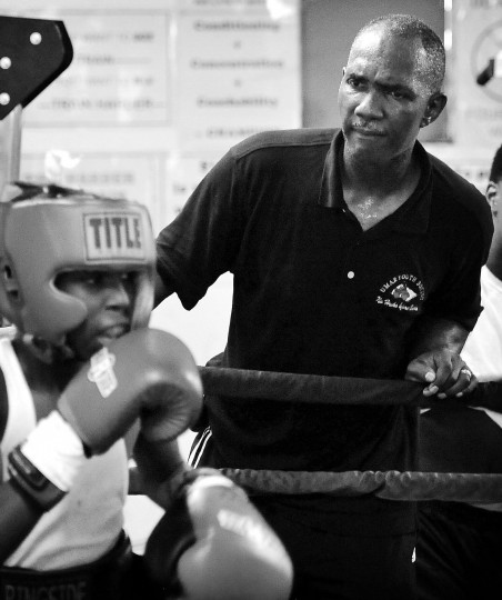 Former pro boxer Marvin McDowell, right, founder, president and executive director of UMAR Boxing Program, Inc., watches and shouts instruction to young boxers. (Kim Hairston/Baltimore Sun)