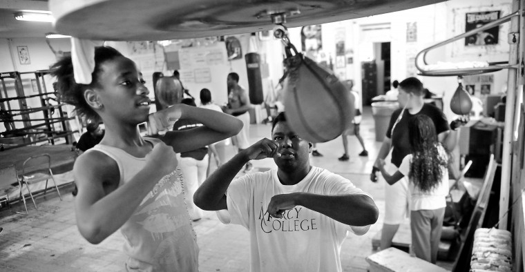 Kawn'nay Barfield, 12, learns how to hit the speed bag as Ronnie Boodoo, fitness and conditioning coach, gives instruction. The mission of UMAR is to reclain community youth from the city streets and prepare them for future roles as produtive citizens according the UMAR website. (Kim Hairston/Baltimore Sun)