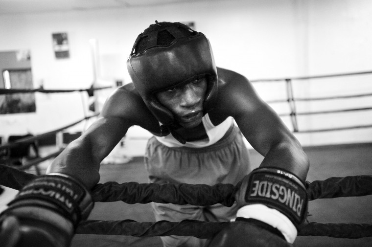 Jermaine Bridgeforth catches his breath after sparring with three other boxers in the ring at UMAR Boxing Program, Inc. on North Avenue. (Kim Hairston/Baltimore Sun)
