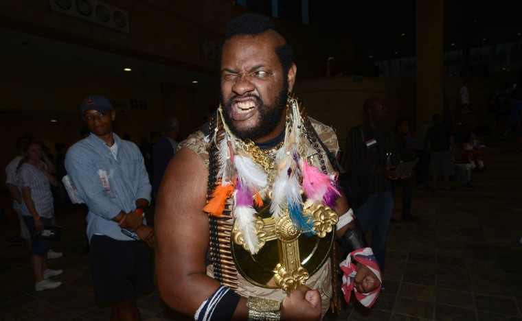 """Mr. T aka Macdaniel Macleod, 39, of Baltimore ordered passing children to """"drink your milk and stay in school."""" (Credit: J.M. Giordano)"""