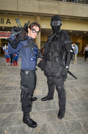 Iggy Tissera, 26, is dressed as the Winter Soldier and former sidekick to Captain America and Andreas Owald, 37, who is dressed as G.I. Joe's Snake Eyes, exchange combat secrets. Both are from Virginia. (Credit: J.M. Giordano)