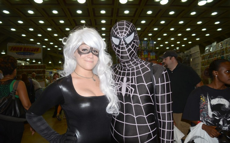 The Black Cat (Chelsea Kohlerman, 21, of Baltimore) and her beau Spiderman (Cal Renner, 24, of Baltimore), in his Venom costume, hugged it out. (Credit: J.M. Giordano)