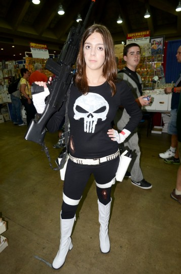 """Lady Punisher (Amy Henricks, 22, Marriotville) poses with her """"little friend."""" (Credit: J.M. Giordano)"""