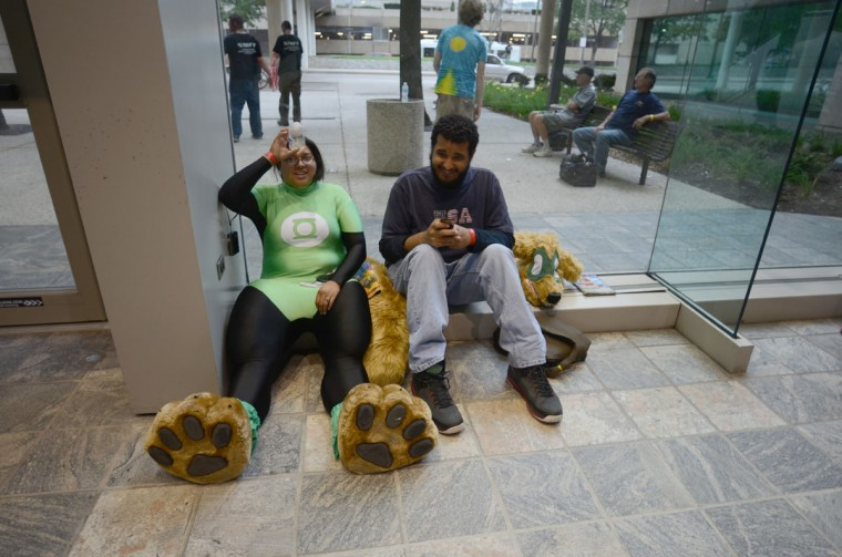 Two Baltimore Comic-Con goers take a break from the heat of the convention center. (Credit: J.M. Giordano)