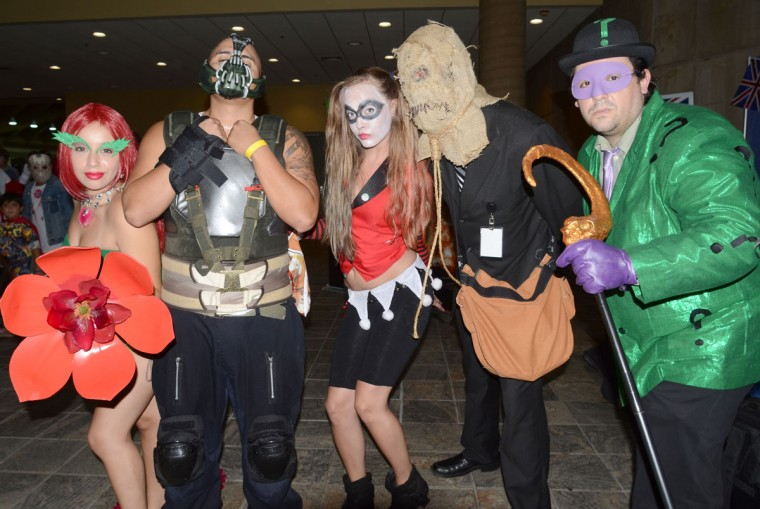 Batman's rogues gallery (from left) Poison Ivy, Bane, Harley Quinn, Scarecrow and The Riddler have something in store for the Caped Crusader. (Credit: J.M. Giordano)