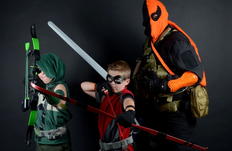 From left: Jake Huffman, 10, as Green Arrow; Matt Huffman, 8, as Red Arrow; Dave Huffman 45, (their father) as Deathstroke the Terminator. All three are from Pasadena. (Credit: J.M. Giordano)
