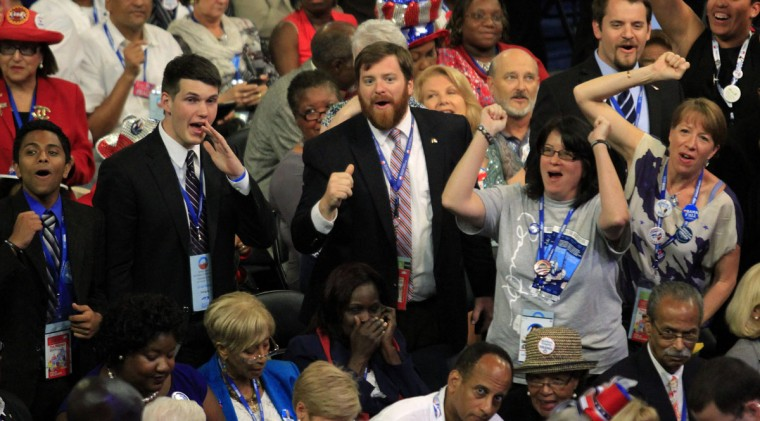North Carolina Delegates yell back and forth with Ohio delegates as they rev up prior to the start of the 2012 Democratic National Convention in Times Warner Cable Arena Thursday, September 6, 2012 in Charlotte, North Carolina. (Steve Jessmore/Myrtle Beach Sun-News/MCT)
