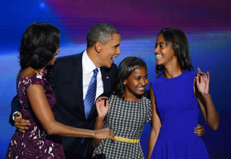 President Barack Obama is joined on stage by his wife, Michelle, and daughters Malia (center) and Sasha at the 2012 Democratic National Convention in Times Warner Cable Arena Thursday, September 6, 2012 in Charlotte, North Carolina. (Harry E. Walker/MCT)