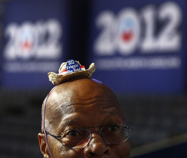 "Chairperson of Texas Senate District 13 Nat West of Houston wears a mini cowboy hat bearing the words, ""No Friggin Big Hats!"" in response to the Republicans hats worn at their convention last week. (Tom Fox/Dallas Morning News/MCT)"
