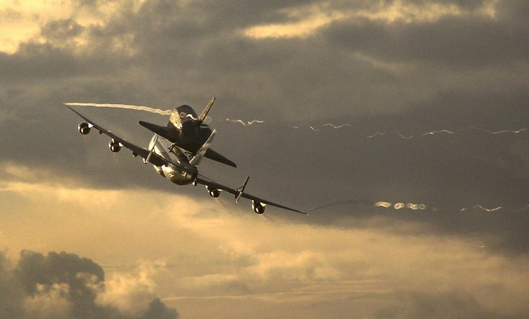 Perched atop a modified Boeing 747, space shuttle Endeavour departed Kennedy Space Center in Florida at 4:22 a.m. EDT Wednesday, September 19, 2012, en route to Houston, the first leg of a two-day trek to California. (Brian van der Brug/Los Angeles Times)