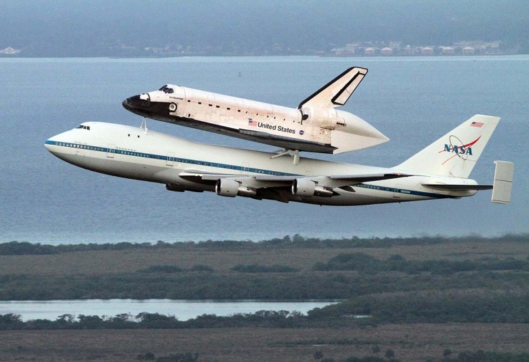 Perched atop a modified Boeing 747, space shuttle Endeavour departed Kennedy Space Center in Florida at 4:22 a.m. EDT Wednesday, September 19, 2012, en route to Houston, the first leg of a two-day trek to California. (Red Huber/Orlando Sentinel)