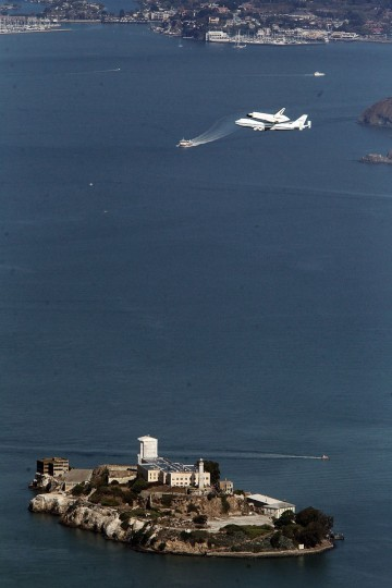 The space shuttle Endeavour makes a pass over Alcatraz during its tour over the Bay Area on Friday in San Francisco, California. (Anda Chu/Oakland Tribune/MCT)