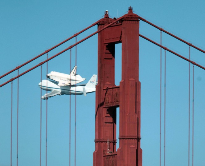 The space shuttle Endeavour flies over the Golden Gate Bridge in San Francisco, California on Friday. The shuttle is on its way to southern California, where it will be displayed in a museum, ending 30 years of the space shuttle program. (Jane Tyska/Oakland Tribune/MCT)