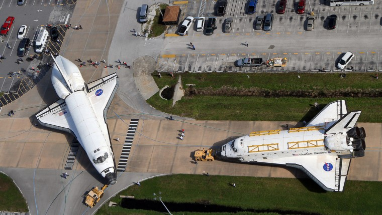 This is the last time that two space shuttles, Endeavour, left, and Atlantis will meet nose-to-nose Thursday, August 16, 2012 at the Kennedy Space Center. The move marked the final time that Endeavour will roll out of an Orbiter Processing Facility, temporarily moving into the Vehicle Assembly Building until September. Endeavour is targeted to depart Kennedy atop the NASA Shuttle Carrier Aircraft in mid-September and fly to Los Angeles International Airport and later become on public display at California Science Center. (Red Huber/Orlando Sentinel)