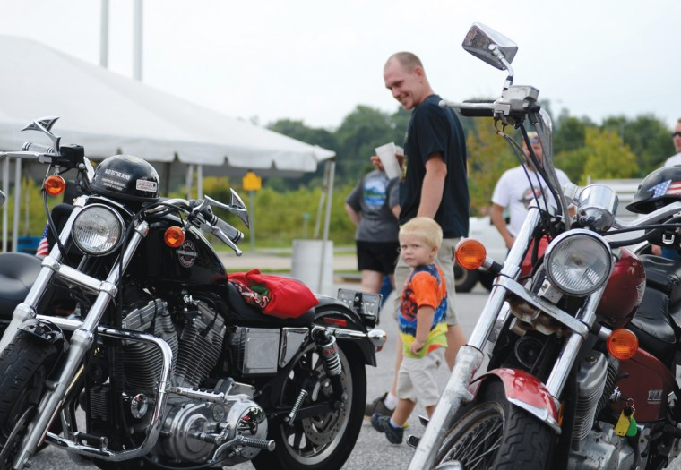 Norm Johnson, of Conowingo, and his 3-year-old son Myles stop by at Chesapeake Harley-Davidson to look at the motorcycles. (Jon Sham/Patuxent Homestead)