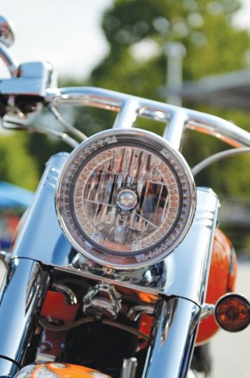 A close-up of the headlight of a motorcycle. (Jon Sham/Patuxent Homestead)