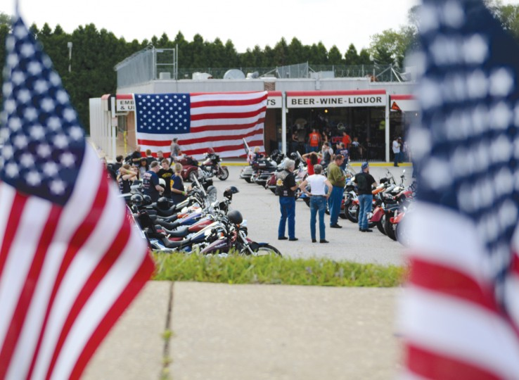 The riders and their motorcycles park in the lot in front of McAvoy's, where the event ended around 12:30 p.m. Saturday. (Jon Sham/Patuxent Homestead)