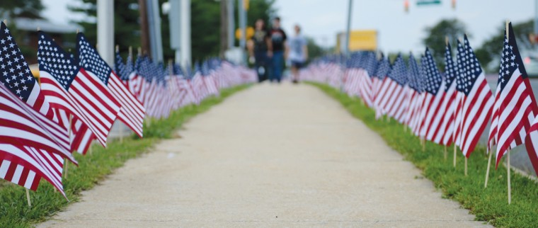 The line of nearly 3,000 flags in Parkville stretched for blocks and blocks leading up to McAvoy's. (Jon Sham/Patuxent Homestead)